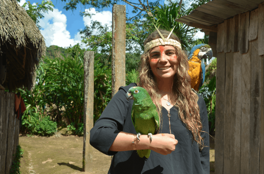 Jazmin holding birds in the Kotococha Community