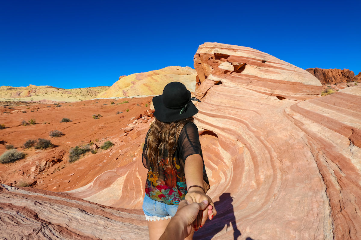 Woman taking her husband to see a rock formation at Valley of Fire State Park
