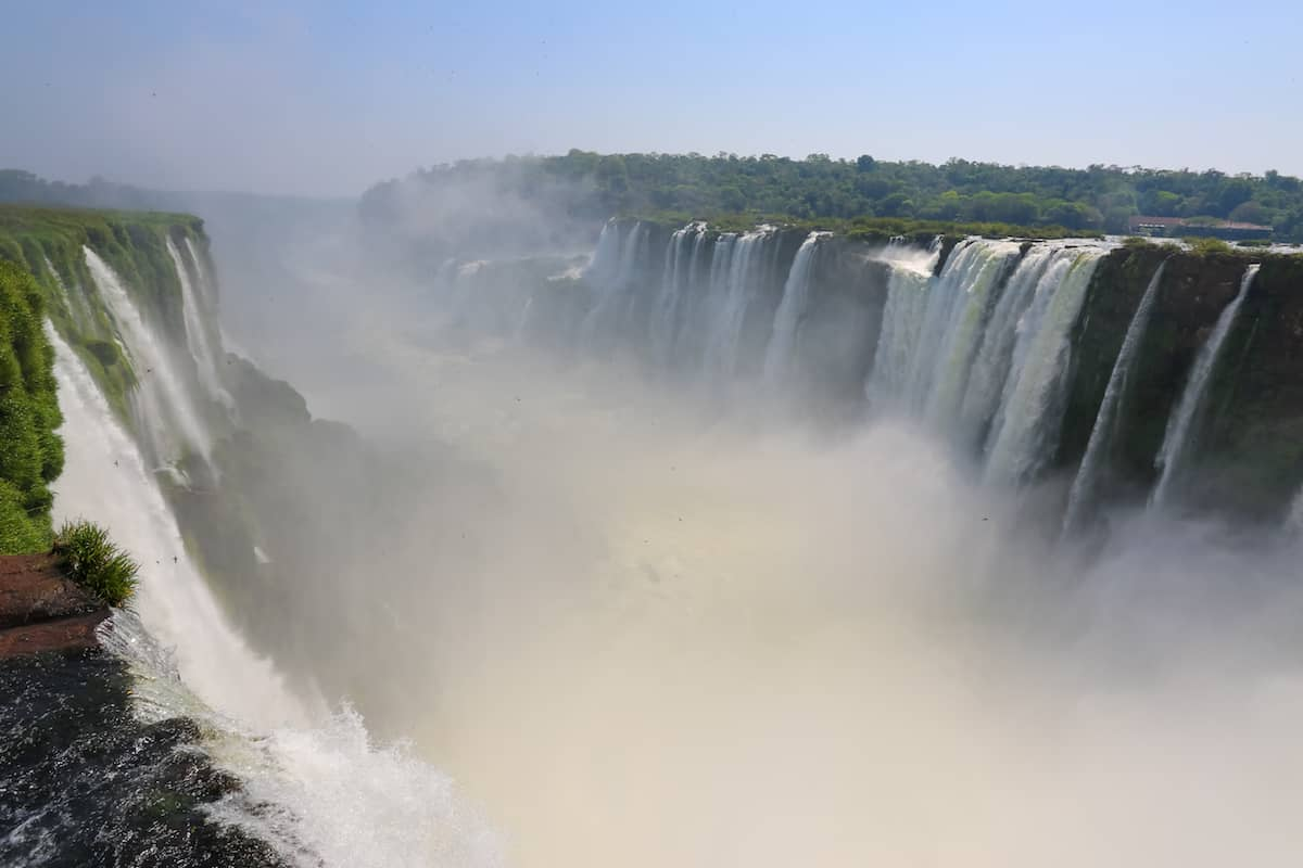 A complete guide to visiting Iguazu Falls in Brazil. Find out everything you need to know about visiting one of the natural wonders of the world!