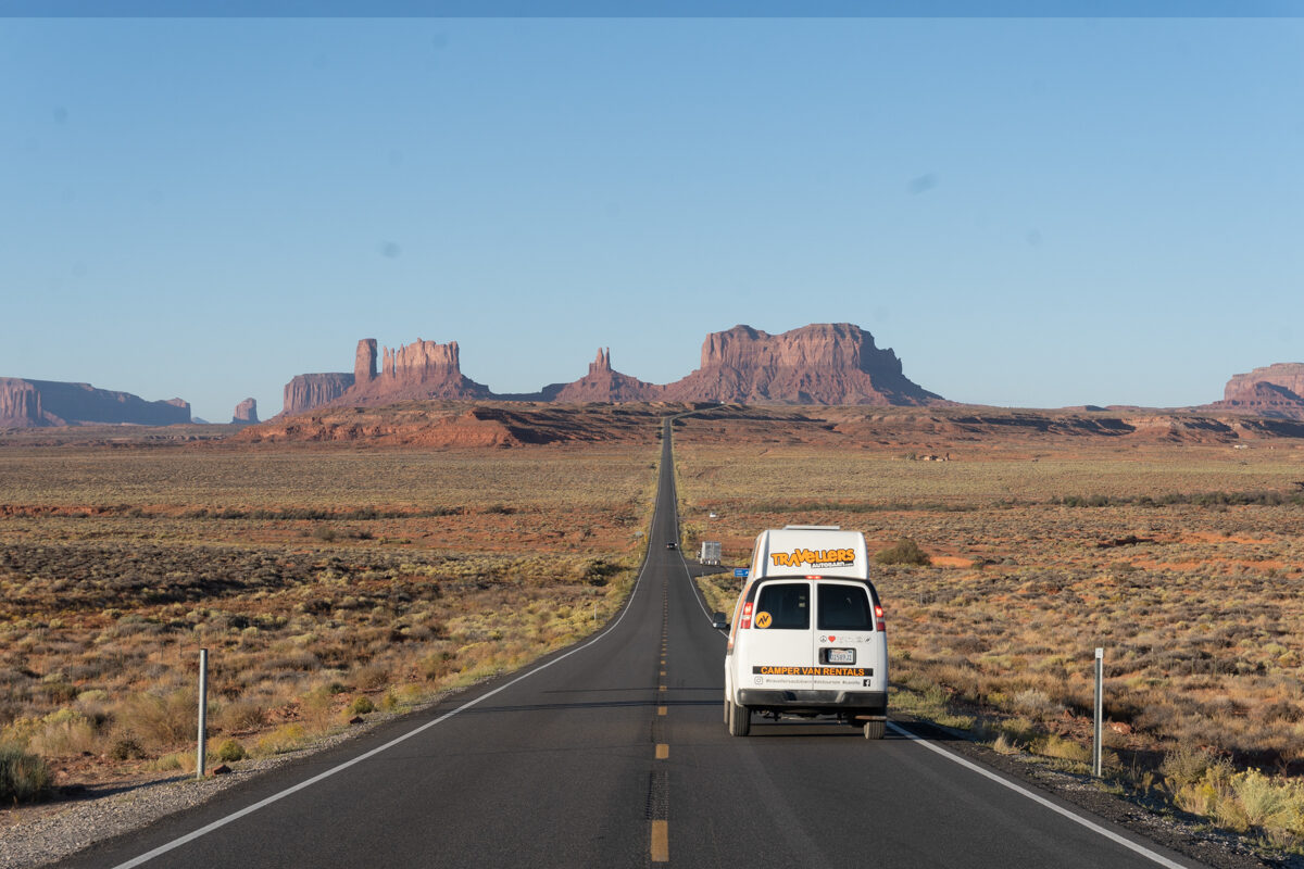 Van driving across Monument Valley in Utah