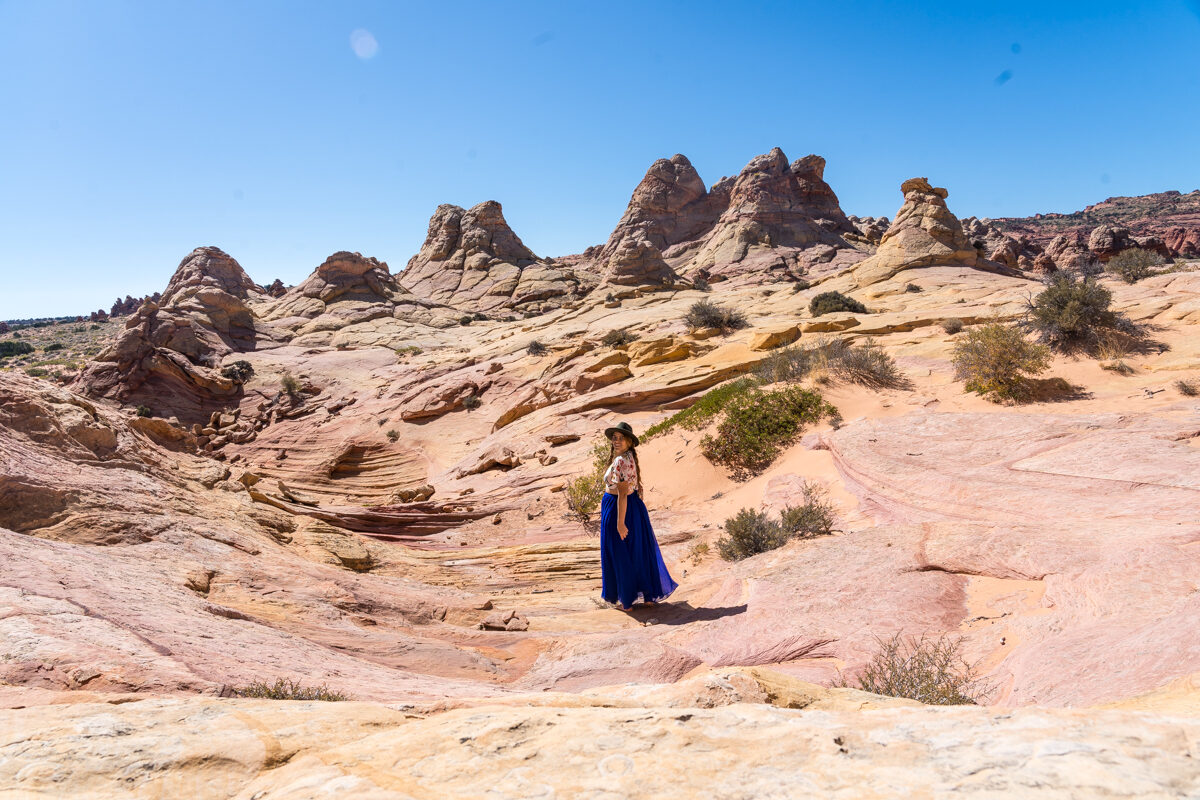 Girl walking around rock formations in Vermillion, Utah