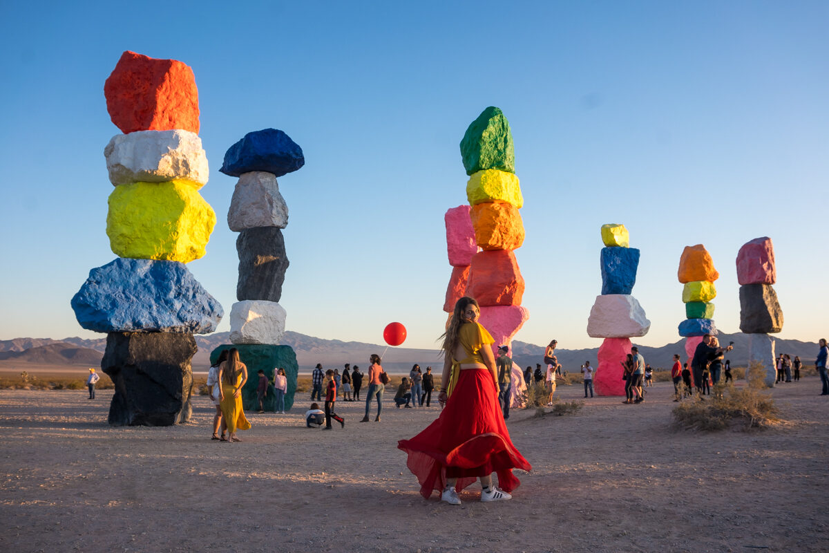 Girl at the 7 Magic Mountains in Las Vegas wearing a red skirt.