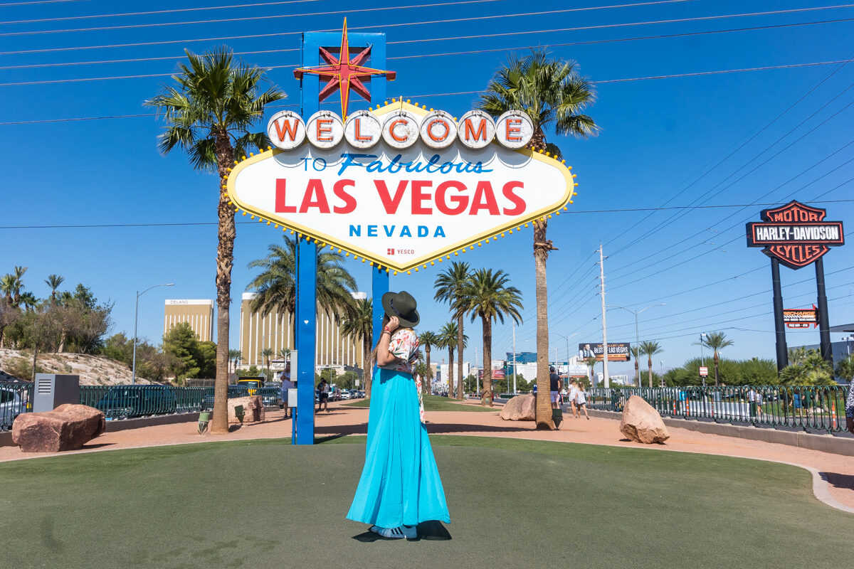 """Girl dancing at the """"Welcome to Fabulous Las Vegas Sign"""" in Nevada."""